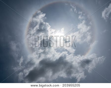 Sun halo on blue sky background, natural phenomenon