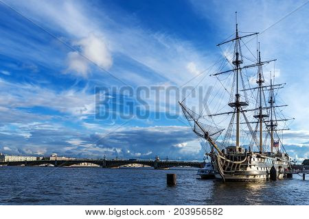 ST.PETERSBURG/RUSSIA - JULY 21, 2017. A sailing ship stands at the pier in the riverbed of the Neva River