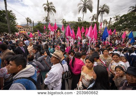 April 14 2017 CotacachiEcuador: indigenous kechwa crowd at the Easter procession in the center of the town