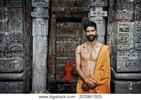 Naggar, India - July 17: Indian Young Brahmin Stands Near The Temple Of Krishna. July 17, 2013 In Na