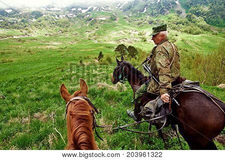 Krasnodar, Russia - July 17, 2015: Huntsman Is A Horse In The Mountains.