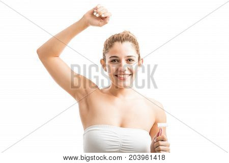 Young Woman Shaving Her Armpits