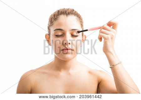 Young Woman Putting Some Eye Shadow