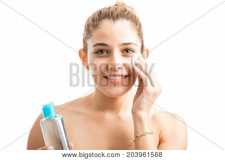 Happy Woman Taking Care Of Her Skin
