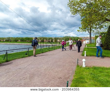 Peterhof, Russia - June 03. 2017. Tourists near the Marlinsky pond and the garden of Venus