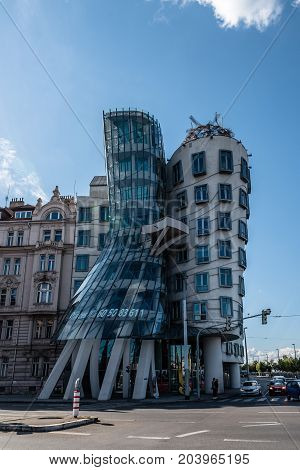Prague, Czech Republic - August 20, 2017: Dancing House building in Prague, also known as Fred and Ginger. It is building in Prague riverfront designed by Frank Gehry architect. Sunny day of summer