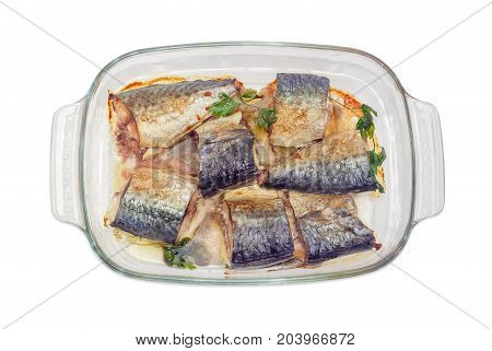 Top view of the rectangular glass pan for baking with baked pieces of Atlantic chub mackerel on a white background