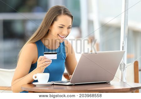 Happy Woman Paying On Line In A Restaurant