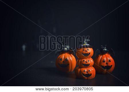 Halloween pumpkins jack-o-lantern on dark background. Halloween pumpkin background. Halloween. jack-o-lantern. Halloween jack-o-lantern. Happy Halloween.