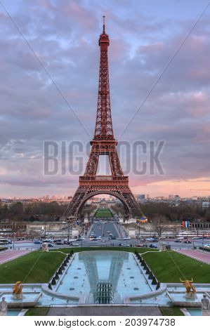 The Eiffel Tower and fountains at sunset. Paris. France