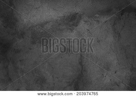 Cement plaster on the wall. Monochrome photo. Background for web design