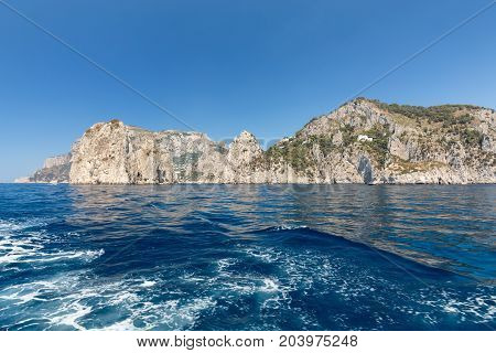 View from the boat on the cliff coast of Capri Island Italy