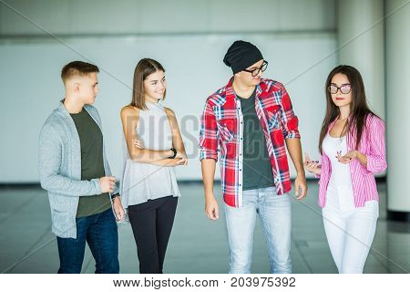 Interested Young Group Of Coworkers Having Necessary Talk