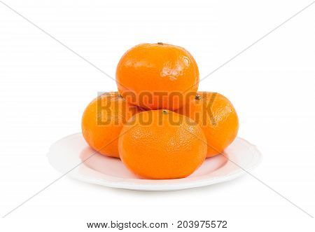 Fresh tangerines (mandarin oranges) in pile of four pieces on white plate isolated on white background (Clipping Path included) to celebrate Chinese new year or special holy occasions