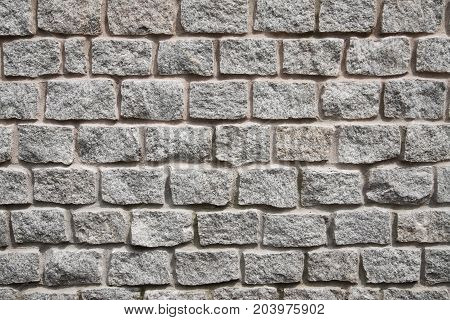 Backgrounds. This picture shows the stone gray granite wall