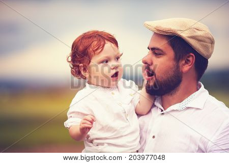 Portrait Of Father And Cute Redhead Son In The Countryside