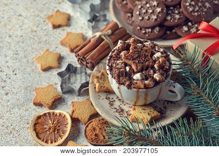 Christmas hot chocolate with marshmallow on a brown background
