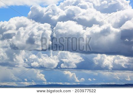 Landscape with a blue sky and rain clouds. Live earth.