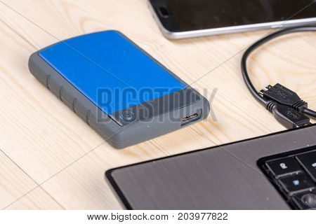 External Hard Disc Hdd On The Wooden Table With Lap Top Computer And Mobile Phone