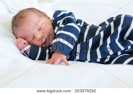 Newborn Baby Laying In Crib In Prenatal Hospital