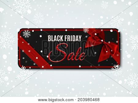 Black Friday sale banner with red ribbon and bow, on winter background with snow and snowflakes.Design template for brochure or banner.