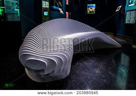 08 July 2017, RUSSIA, VLADIVOSTOK : White bench in hi-tech style in the aquarium Vladivostok, Russia
