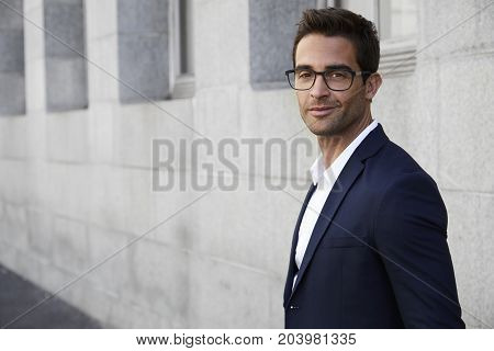 Handsome Suited businessman smiling in glasses portrait