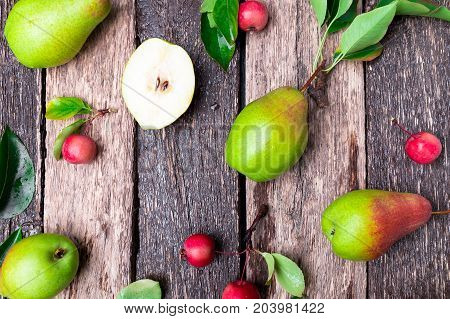 Pear And Small Apple On Wooden Rustic Background. Top View. Frame. Autumn Harvest.