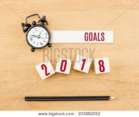 Goals 2018 Year Red On Wood Cube With Pencil And Clock Top View On Wood Table,new Year Business Conc