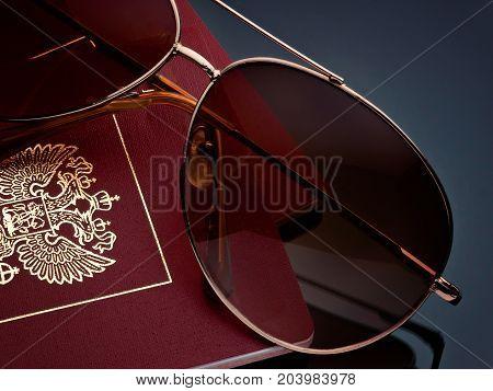 Travel tourism concept sunglasses passport on gray background gradient