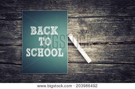 Back to school text written on green chalkboard