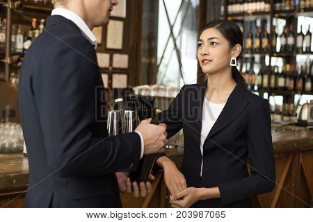 Woman With Agreement For Working With Businessman At Bar. Business Team Concept.