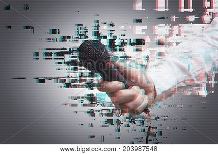 Unrecognizable man with microphone digital glitch effect.