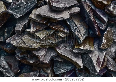 The pattern of the variegated sandstones. Layers of toned colored mica stones. Rock Landslide. Shiny silicate mineral storage space of various fantastic sandstone. Cracks of sandstone background
