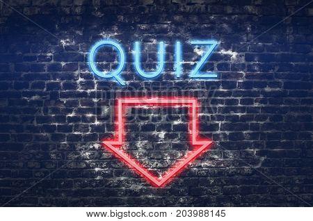 Quiz neon sign on dark brick wall background