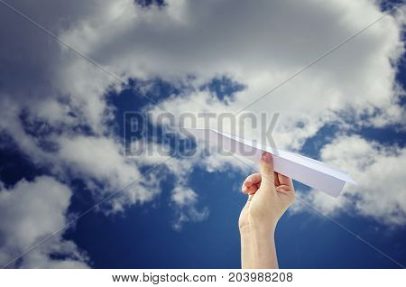 Hand with paper airplane for fly to the sky with dream lifestyle. Freedom concept.