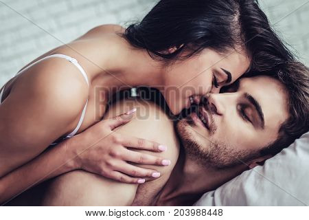 Young Love Couple In Bed