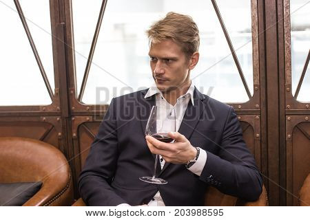 Portrait Of A Handsome Businessman Sitting In Restaurant, Man With Business Concept.