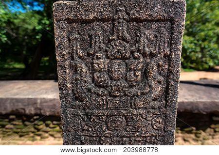 Srilankan ancient floral pattern carved in sandstone. Polonnaruwa, Sri Lanka