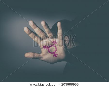 Transgender symbol painted in the palm of unrecognizable person