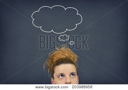 Thinking woman with thinking bubble on blackboard background