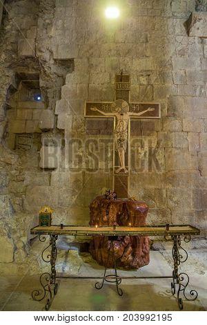 Kutaisi, Georgia 18 June, 2017: Cross with Jesus in the old Gelati temple in Kutaisi Georgia