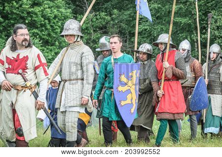 MOSCOW, RUSSIA-June 06, 2016: Warriors in ancient costumes are marching to battlefield.