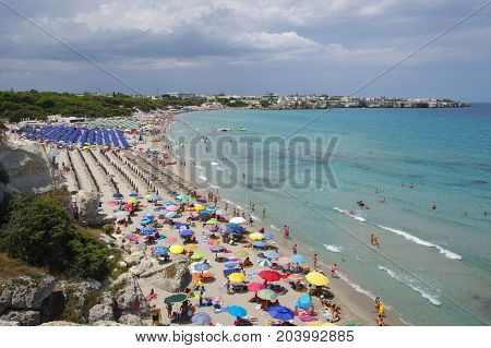 LECCE ITALY - JULY 26 2017: crowded colorful beach of Torre dell Orso before a storm