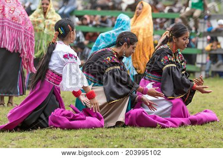 May 27 2017 Sangolqui Ecuador: indigenous female dancers performing at the opening of a rural rodeo