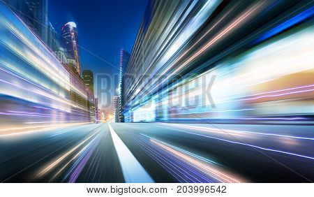 Moving forward motion blur background with light trails night scene .