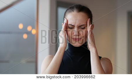 Headache Tense Woman at Work in Office