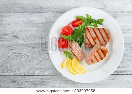 Grilled Tuna Steak With Salad And Lemon