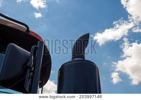 New tractor exhaust pipe. blue sky background