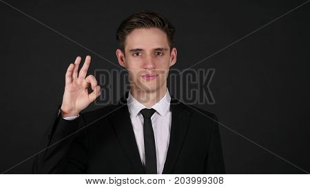 Okay Sign By Businessman, Dark Black Background